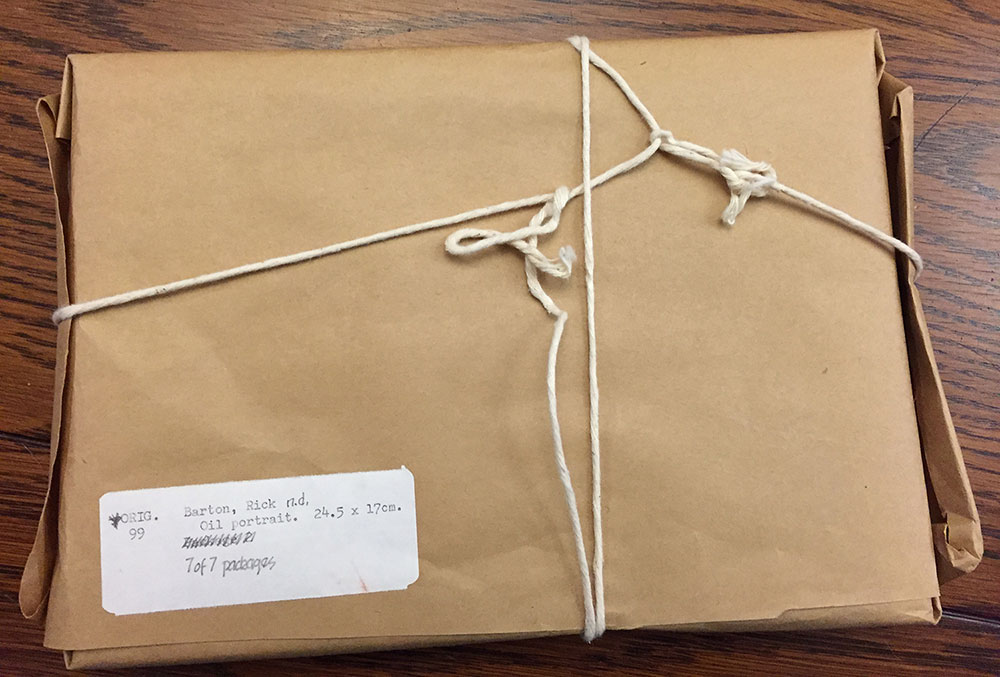 Package wrapped in bown paper and tied with twine
