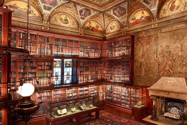 Photograph of J. Pierpont Morgan's Library interior showing bookshelves and tapestry.