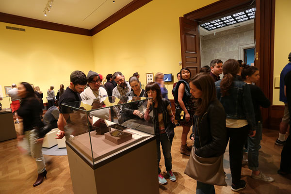 Visitors in a museum gallery.